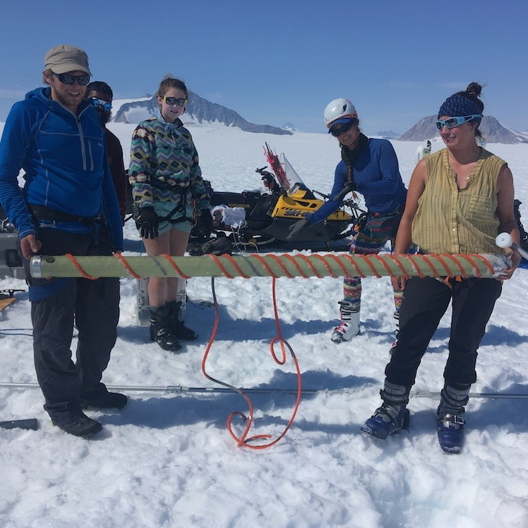 scientists with broken ice core